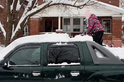 girls-cleaning-snow-off-truck