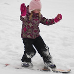 mia-riding-a-snowboard